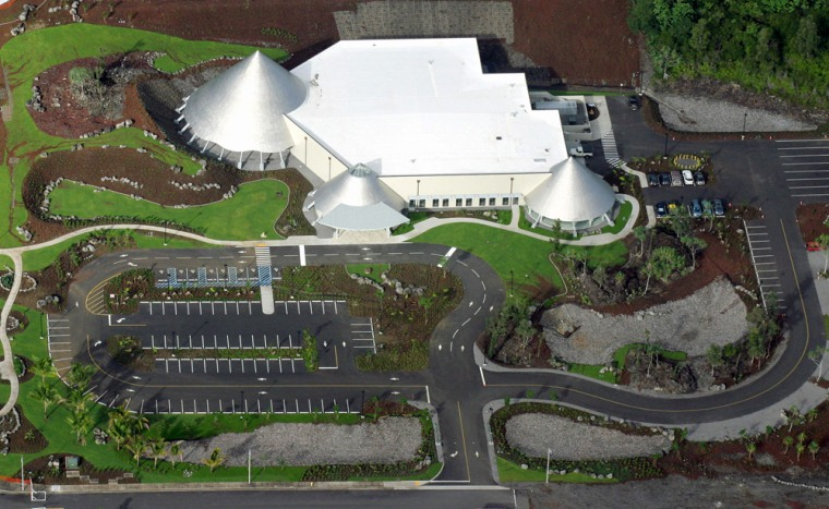 An aerial overview of the Imiloa Astronomy Center, with its three titanium-sheathed domes that represent the Mauna Kea and other volcanoes.