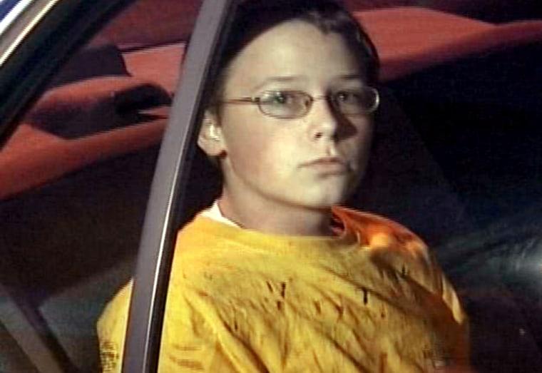 Kenneth Bartley Jr. is taken awayby policeafter he was accused of shooting three people on Nov. 8, 2005, in Jacksboro, Tenn.