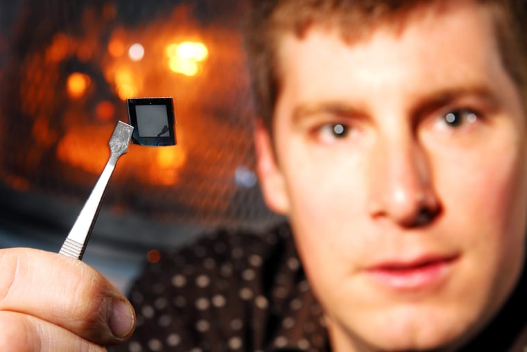 Jud Ready, senior research engineer at the Georgia Tech Research Institute, holds a sample of the 3D solar cells his research team has developed.