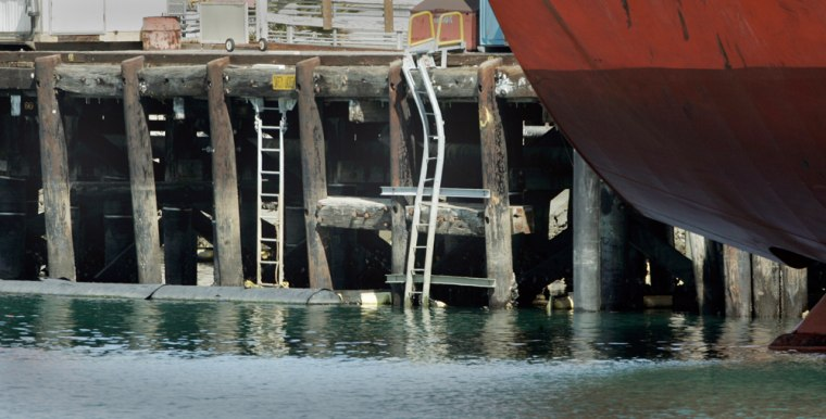 """A pier at a Valero oil terminal at the Port of Los Angelesshows damage to ladders and so-called """"sacrificial"""" pilings designed to be replaced."""