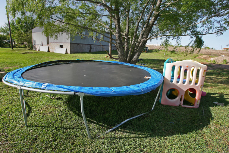 Daniel Galicia, 7, was bouncing on this trampolinewith family members when he was hit by a stray bullet and died. A neighbor, Jose Barrera Espitia, 37, was arrested and charged Wednesday with second-degree manslaughter.