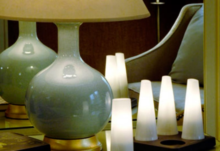 Lighting a hotel room with candles instead of electricity is one way environmentally-conscious travelers can stay green.