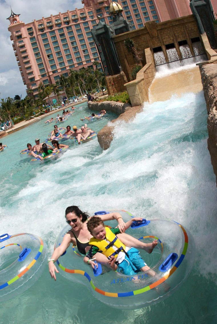 Atlantis guests ride tubes through a series of rapids along the new Aquaventure Current ride at the Atlantis resort hotel, on Paradise Island in the Bahamas.