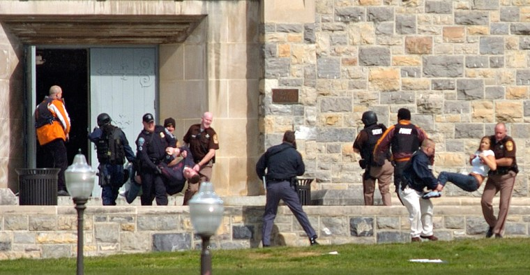 Injured peopleare carried from a dormat Virginia Tech after a gunman opened fire Monday.