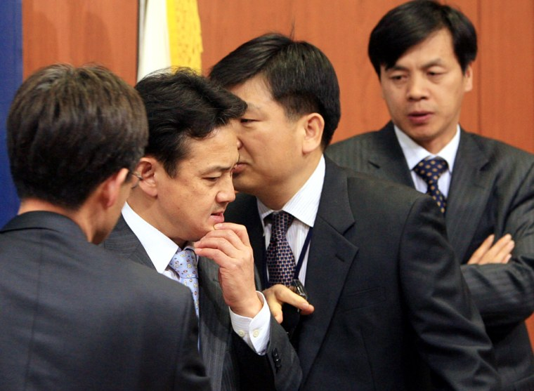 South Korean Foreign Ministry officials confer Tuesday at their office in Seoul.