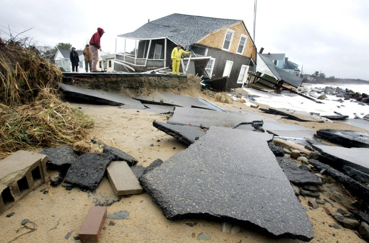 The remains of a shorefront road lay on the beach Tuesday near homes destroyed by a severe nor'easter that lashed the East Coast in the Ferry Beach section of Saco, Maine.