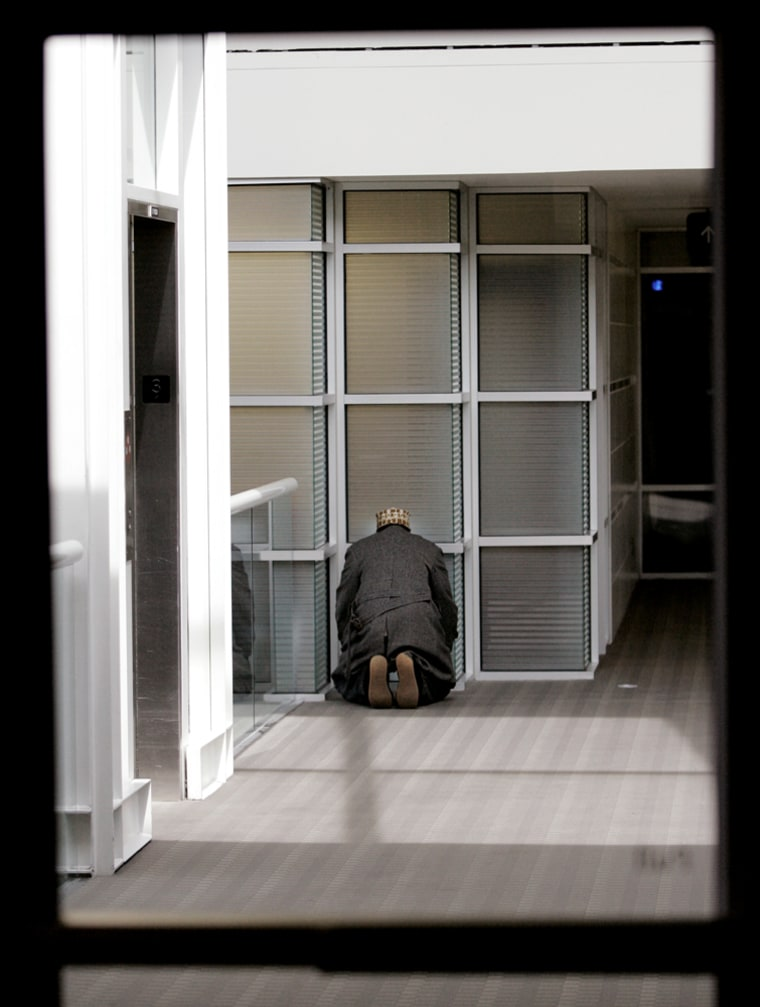A Muslim cab driver takes time for afternoon prayers outside the meeting room at the Minneapolis-St. Paul International Airport in Minneapolis. Taxi drivers who refuse service to travelers carrying alcohol at the Minneapolis-St. Paul International Airport face tougher penalties despite protests from Muslims cabbies who sought a compromise for religious reasons, officials said Monday.