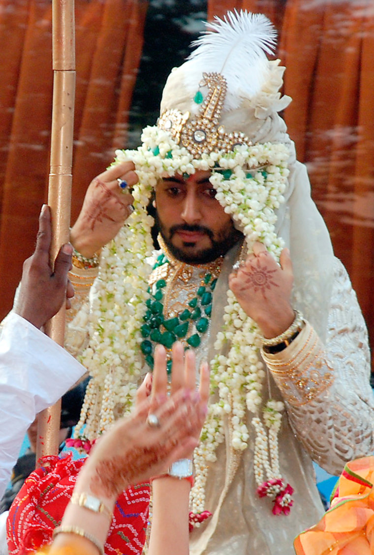 Bollywood star Bachchan rides a horse as he arrives for his wedding in Mumbai