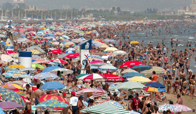 Crowds flock to a beach in Valencia. Spain's third-largest city will have it's time in the spotlight when it hosts the 32nd America's Cup.