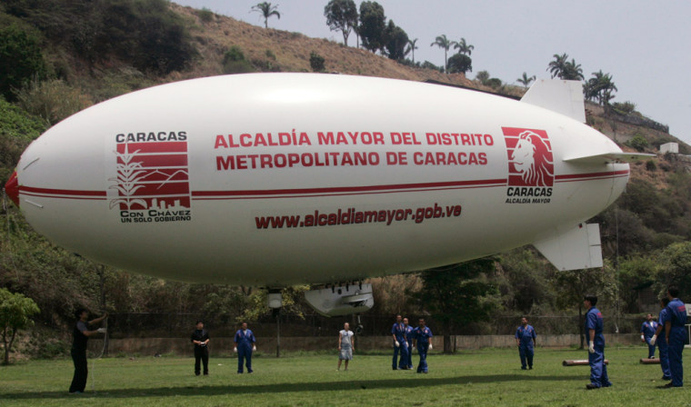 Workers prepare to launch a Zeppelin in Caracas