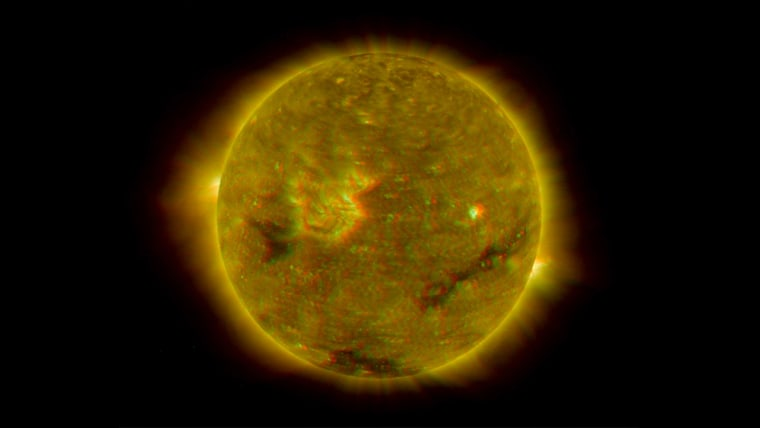 Data from the twin STEREO spacecraft in four different wavelengths were combined to create this image of the sun's disk. The image's colors have been enhanced to produce a three-dimensional effect when viewed with red-blue glasses.