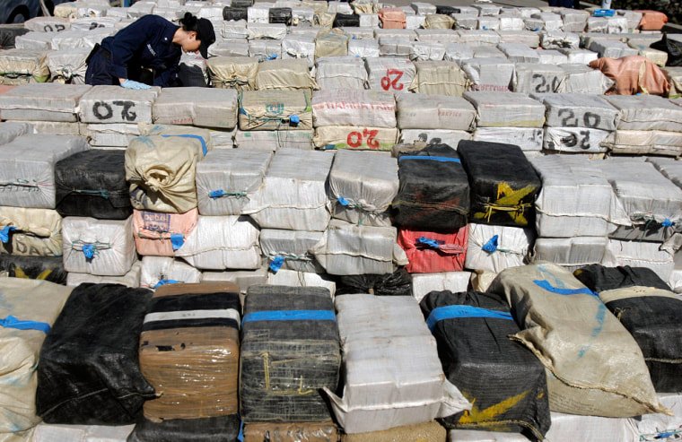 U.S. Coast Guard Petty Officer 3rd Class Danielle Desvergers looks throughsome of the more than 40,000 pounds of cocaine — worth an estimated $500 million — offloaded from Coast Guard Cutter Sherman at Coast Guard Island in Alameda, Calif., on Monday.