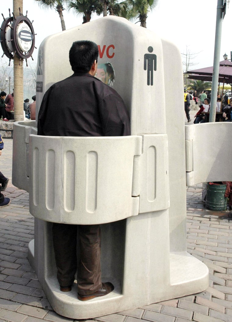 A man uses a controversial outdoor toilet in southwest China's Chongqing Municipality