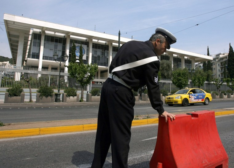 A police officer stands guard outside the U.S. Embassy in central Athens onWednesday.