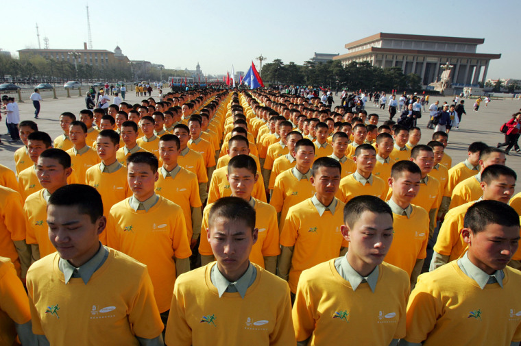 Chinese soldiers prepare to take part in a mass run held to mark 500 days until the opening of the 2008 Beijing Olympic Games, in Beijing's Tiananmen Square Sunday March 25, 2007.