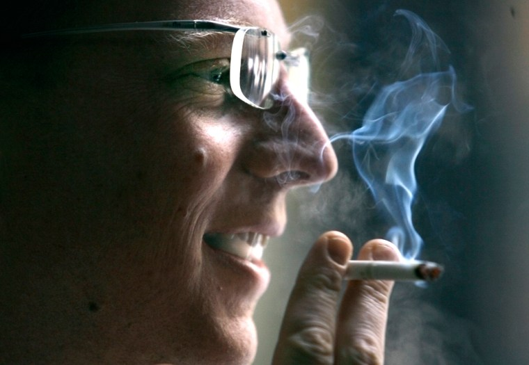An office worker enjoys a cigarette in downtown Toronto
