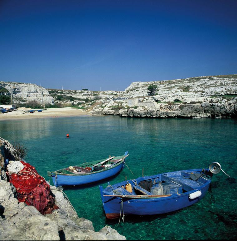 Fishing boats are tied up in Porto Badisco, in southern Italy's Puglia region.