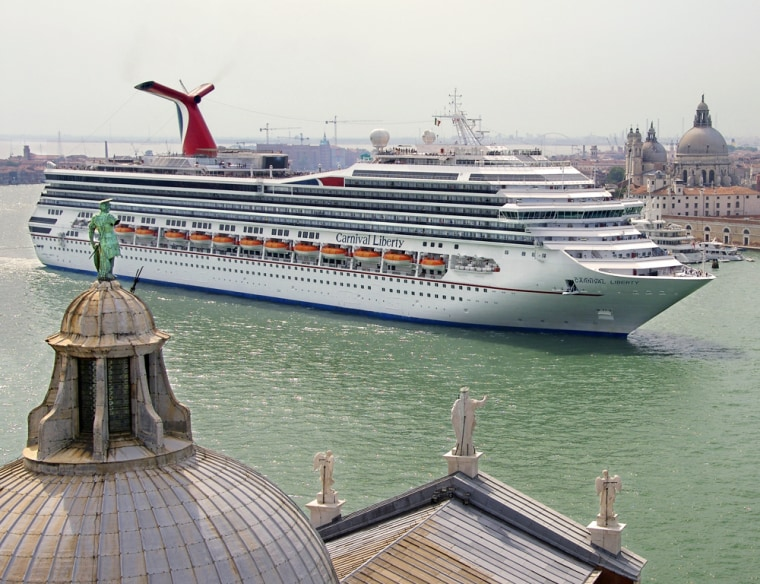The Carnival Liberty cruises down the Grand Canal in Venice, Italy. All-inclusive cruises don't cover expenses like shore excursions, alcoholic drinks andlaundry, so it's a good idea to have some cash.