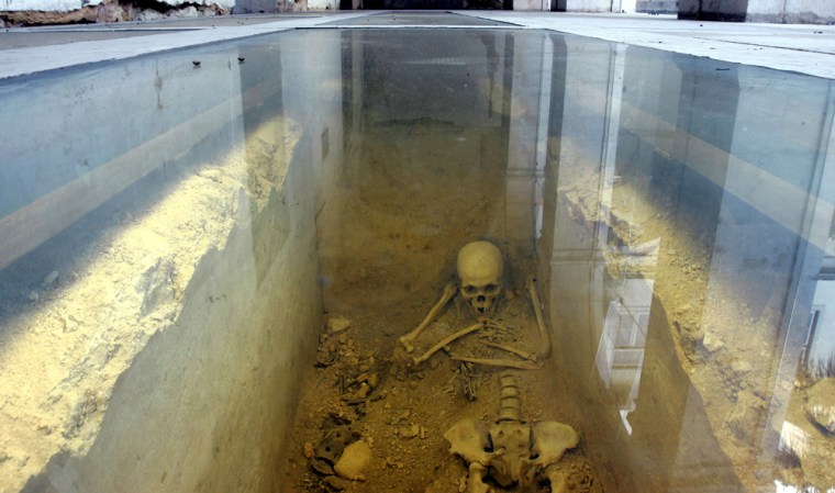 A skeleton is seen behind a glass at a 17th-century convent, home of Lisbon's Academy of Sciences in Lisbon, Portugal. Countless human bones believed to belong to victims of Lisbon's 1755 earthquake were found in a mass grave during restoration works at the academy.