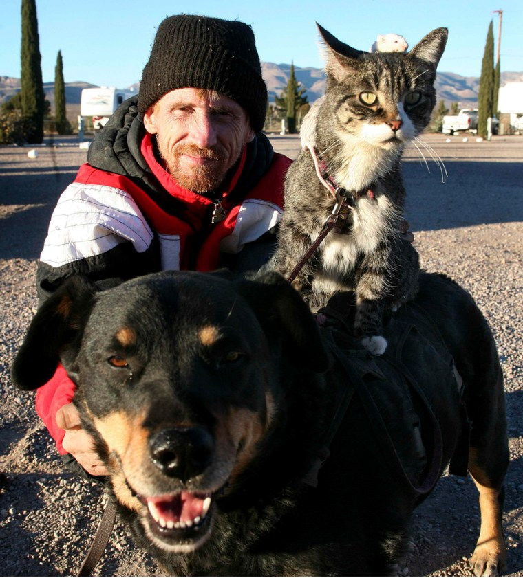 Greg Pike with his dog, cat and mice at his home in Naco, Arizona