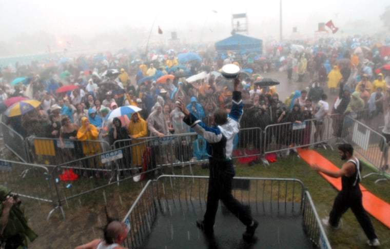 Johnny Sketch & the Dirty Notes wave goodbye to the crowd after heavy rain forced them to stop at the New Orleans Jazz and Heritage Festival onFriday.