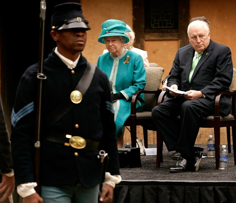 Britain's Queen Elizabeth II and U.S.Vice President Cheney watch actors take part in a ceremony at the fort at Jamestown Settlement museum in Williamsburg, Virginia