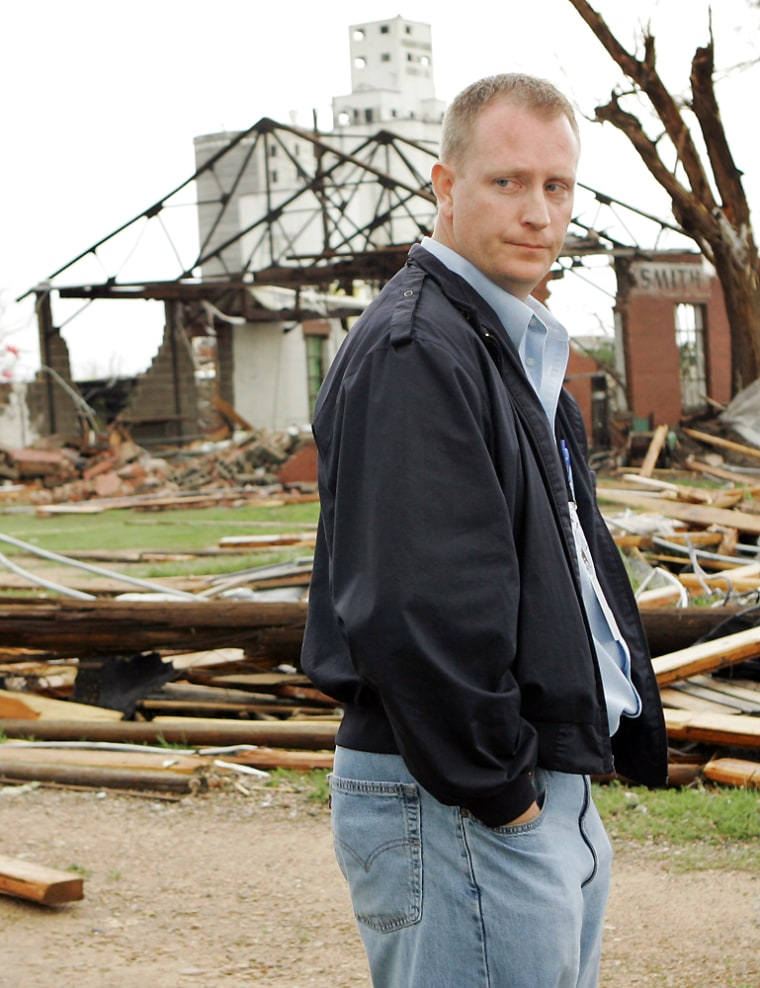 City administrator Steve Hewitt stands in the ruins of Greensburg, Kan., on Sunday after atornado ripped through the area late Friday.