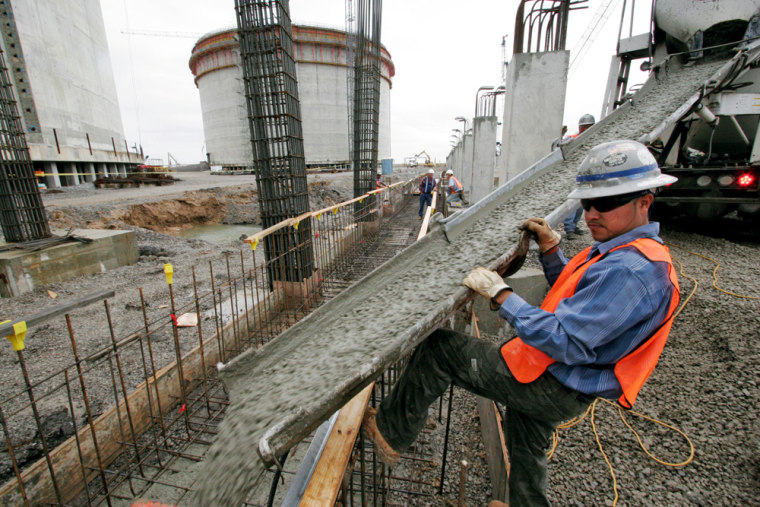 Salvador Pantoja directs the flowing concrete at the Sempra liquefied natural gas plant under construction in Hackberry, La. The facility is scheduled to open in 2008.