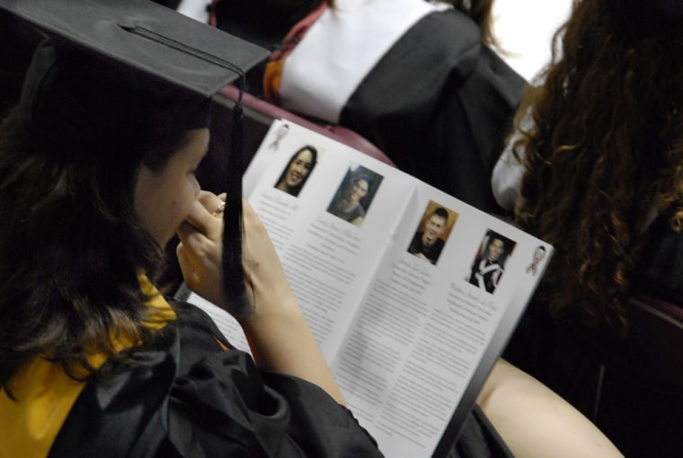A Virginia Tech graduate student wipes away tears as she reads the biographies of her slain classmates during graduation ceremonies at Cassell Coliseum in Blacksburg, Va., on Friday.