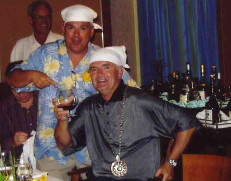 Then-Congressman Jim Gibbons, seated,toasts with Dennis Montgomery during a March 2005 cruise. Montgomery has now accused Gibbons of accepting cash on the trip.