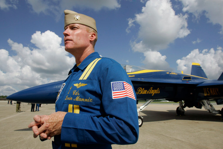 Cmdr. Kevin Mannix of the U.S. Navy flight demonstration team, the Blue Angels, stands by his F/A-18 Hornet at Seymour Johnson Air Force Base in Goldsboro, N.C., on Thursday. Saturday's show featured only five jets, and an investigation into the April 21 crash that killed a member of the team continues.