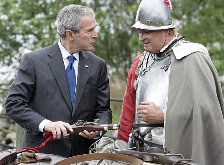 President Bush speaks Sunday with Gregory Schenek about a 17th-century matchlock weapon duringthe president'svisit to the Jamestown Settlement in Virginia, markingits 400th anniversary.