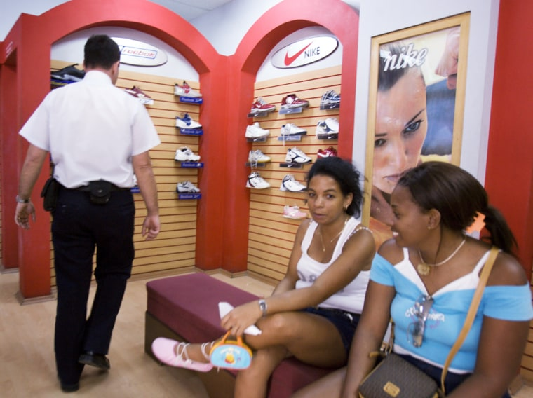 Nike shoes hang on a wall display for sale at a shoe store in Havana. Some brand-name mechandise is authentic, but some are knockoffs.