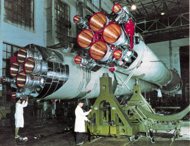 Technicians work on an R-7 rocket booster inside a Russian production facility. The R-7, which was first launched 50 years ago, set the stage for hundreds of launches to come.