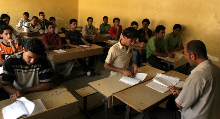 Students attend class in the Sadr City neighborhood of Baghdad, Iraq, on Monday. Many students forego school because they encounter too much violence on their walk there.