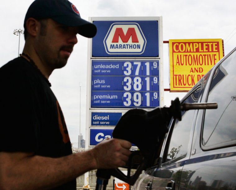 Eddie Engels of Chicago finishes pumping over $83 of gas into his GMC Yukon near downtown on Tuesday.