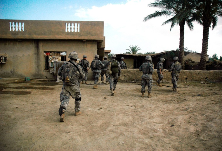 In thisphoto released by the U.S. Army, soldiers of the 4th Battalion, 31st Infantry Regiment, 2nd Brigade Combat Team, 10th Mountain Division (Light Infantry) of Fort Drum search Iraqi homes on Monday.