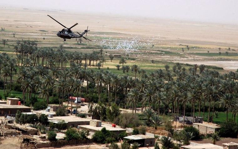 A US helicopter drops reward leaflets ov