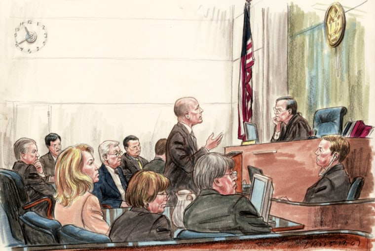 Valerie Plame Wilson, left foreground, watches as Karl Rove's attorney Bob Luskin argues to dismiss her civil suit against administration officials.
