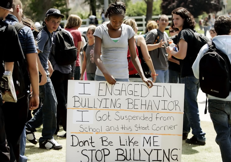 Miasha Williams, 12, looks down as she holds a sign for Temecula Valley High School students to see as school lets out for theday Wednesdayin Temecula, Calif.