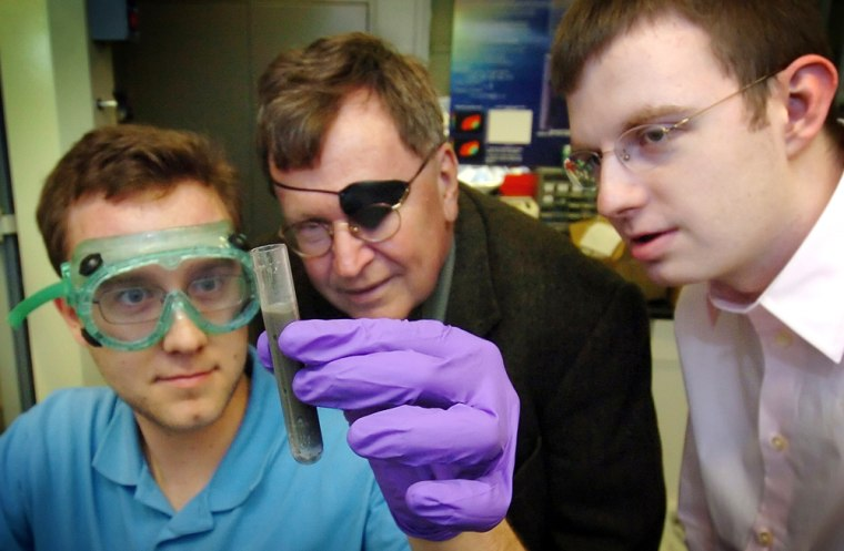 Purdue professor Jerry Woodall, center, and researchers Charles Allen and Jeffrey Ziebarthdisplayhydrogen gascreated by adding water to an alloy of aluminum and gallium.