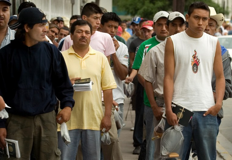 Mexicans line up outside theU.S. Consulate in Monterrey, Mexico, Thursday as they wait for interviews to getwork visas.