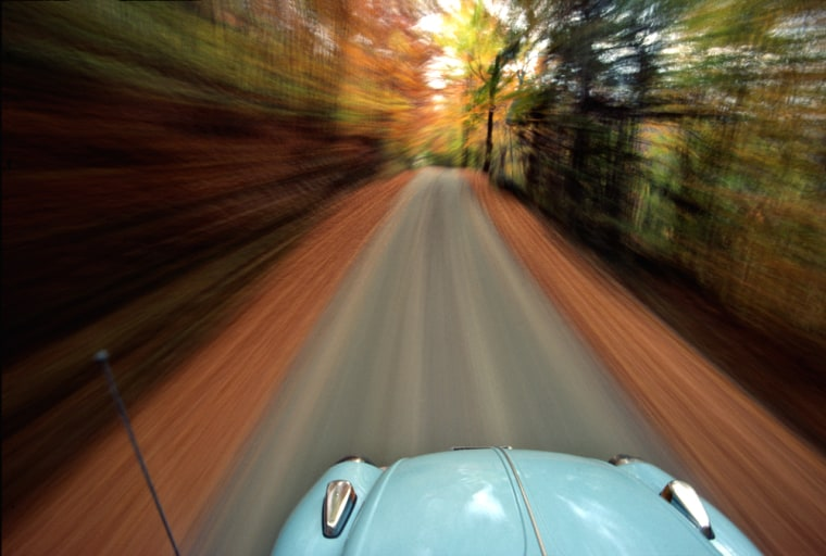 VW Beetle road trip, Vermont, USA. (motion blur)