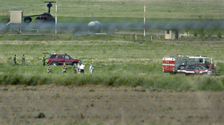 Malmstrom Air Force Base emergency crews respond to the crash site of a Canadian Forces Snowbird aircraft that crashed during an airshow rehearsal Friday in Montana.