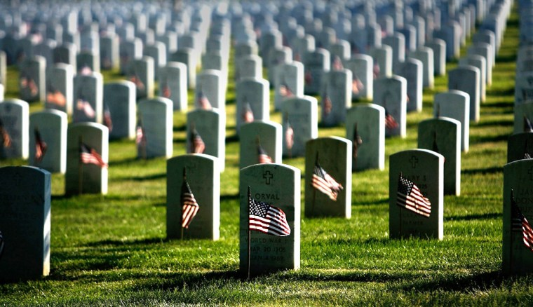 Flags Are Placed At Arlington National Cemetery Graves