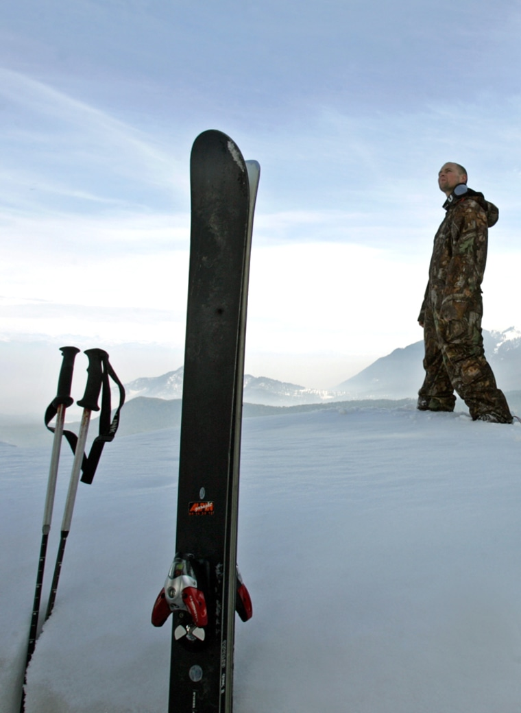 File photo of a Norwegian skier walking past his skis in Gulmarg