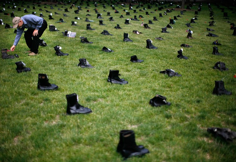Michael McConnell looks at one of more than 3400 pairs of combat boots in Chicago