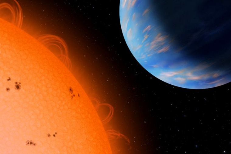 An artist's conception shows the Neptune-sized planet GJ436b (right) orbiting an M dwarf star, Gliese 436, at a distance of only 3 million miles.