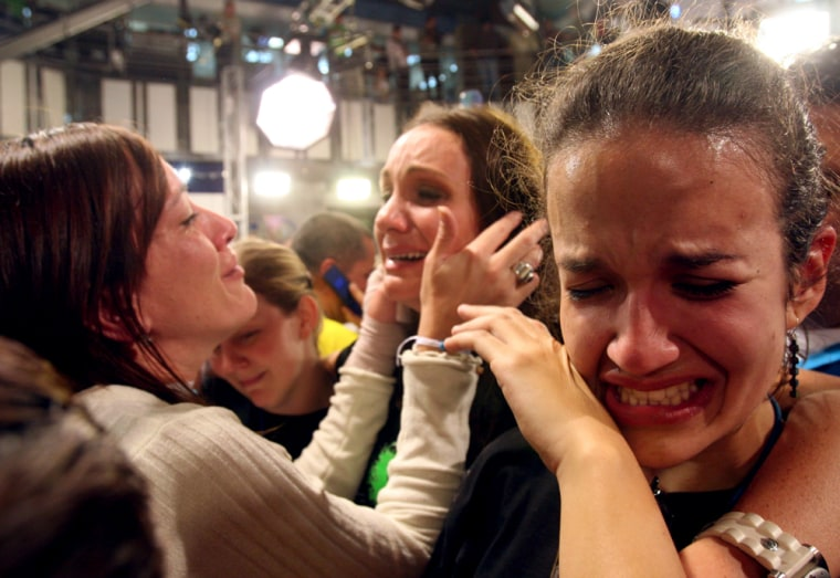 Employees of Radio Caracas Television cry as the channel's signal is cut in Caracas, Monday, May 28, after President Chavez decided not to renew the the opposition-aligned channel's broadcasting license.