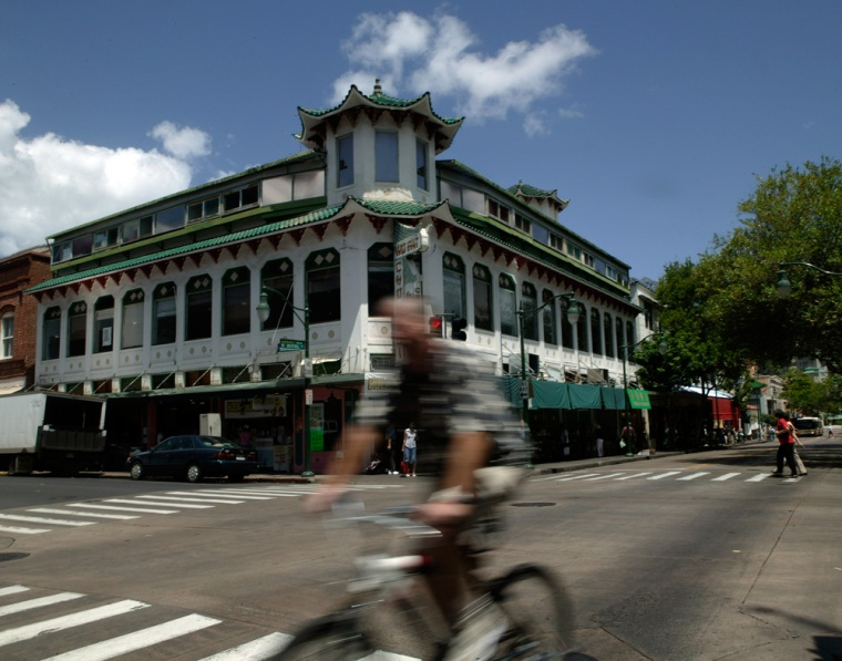 A bicyclist rides past the Wo Fat building in Chinatown, in Honolulu. Shedding a history filled with prostitution, gambling dens and streets plagued by drug dealers, Honolulu's Chinatown neighborhood once walked by the fictional detective Charlie Chan has finally begun to emerge from its dark past.